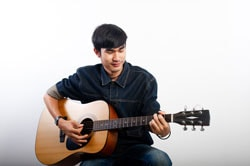 Acoustic guitarist is holding the guitar. and playing guitar concepts of hobbies