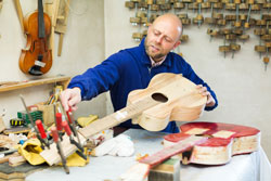 Atelier posing with his guitars