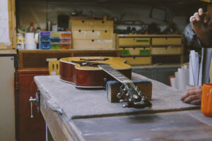 working on repairing a guitar