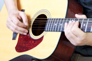 Man play acoustic guitar